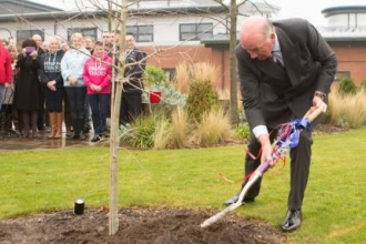 General the Lord Dannatt planting trees at Chavasse VC House